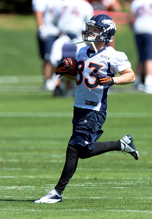 . Wes Welker of the Denver Broncos runs up filed after catching a pass during the teams OTAs May 20, 2013 at Dove Valley. All offseason training activities (OTAs) are voluntary until the mandatory minicamp June 11-13. (Photo By John Leyba/The Denver Post)