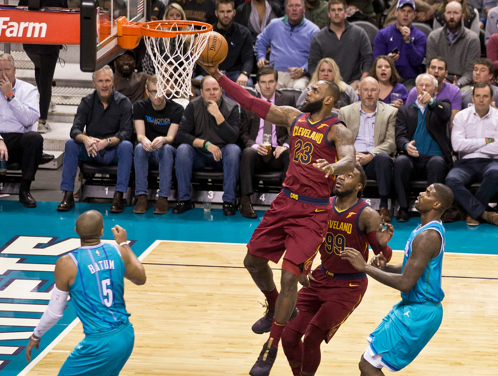. Cleveland Cavaliers\' LeBron James (23) goes to the basket against the Charlotte Hornets during the first half of an NBA basketball game in Charlotte, N.C., Wednesday, Nov. 15, 2017. (AP Photo/Chuck Burton)