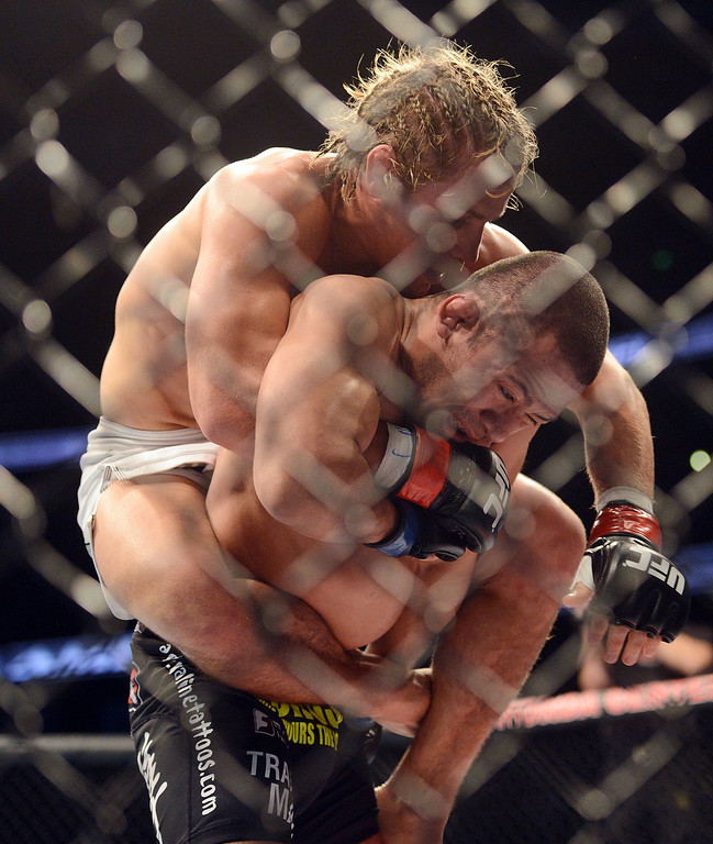 . Urijah Faber sets up a rear-naked choke on  Ivan Menjivar during their UFC 157 match at the Honda Center in Anaheim Saturday, February  23, 2013.  Faber beat Menjivar via 1st round rear-naked choke submission. (Hans Gutknecht/Staff Photographer)