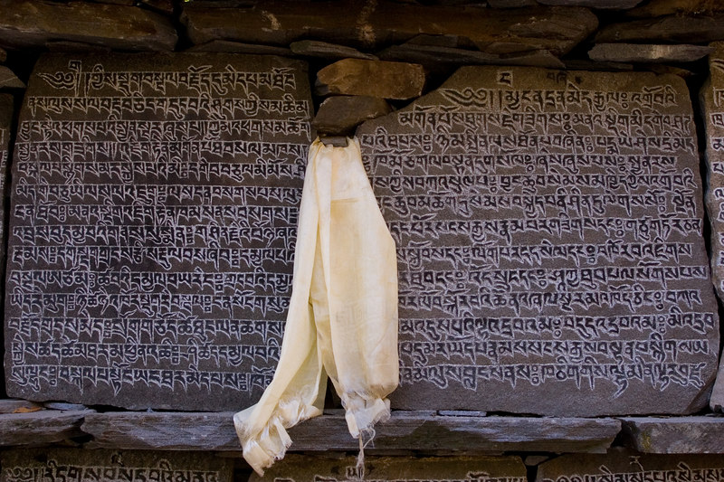Roadside inscriptions on stone on the Manaslu trail.