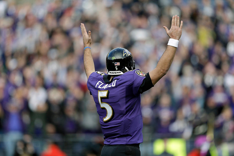 . Baltimore Ravens quarterback Joe Flacco celebrates a touchdown during the first half of an NFL wild card playoff football game against the Indianapolis Colts Sunday, Jan. 6, 2013, in Baltimore. (AP Photo/Patrick Semansky)