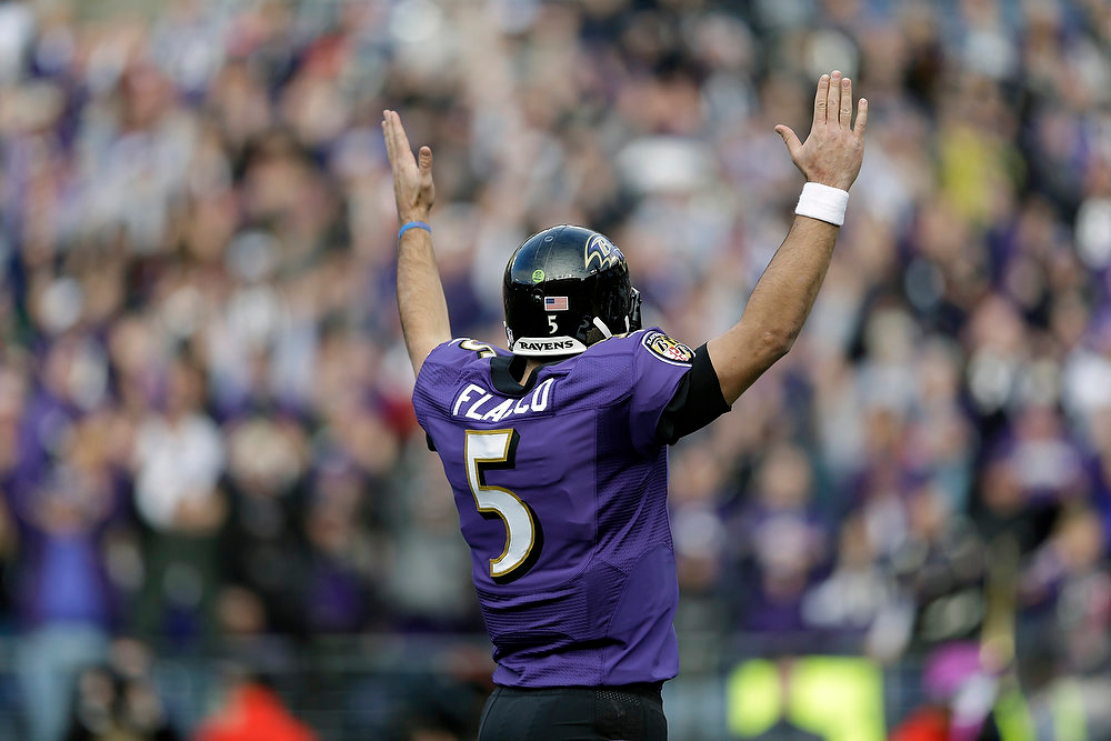 Description of . Baltimore Ravens quarterback Joe Flacco celebrates a touchdown during the first half of an NFL wild card playoff football game against the Indianapolis Colts Sunday, Jan. 6, 2013, in Baltimore. (AP Photo/Patrick Semansky)