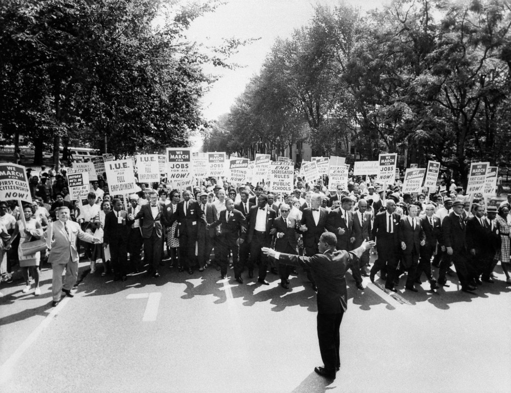 ". The clergyman and civil rights leader Martin Luther KIng (C) and other black and white civil right leaders march 28 August 1963 on the Mall in Washington DC during the ""March on Washington\"". King said the march was \""the greatest demonstration of freedom in the history of the United States.\"" OFF/AFP/Getty Images"