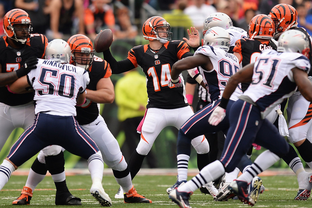 . Quarterback Andy Dalton #14 of the Cincinnati Bengals passes in the second quarter against the New England Patriots at Paul Brown Stadium on October 6, 2013 in Cincinnati, Ohio.  (Photo by Jamie Sabau/Getty Images)