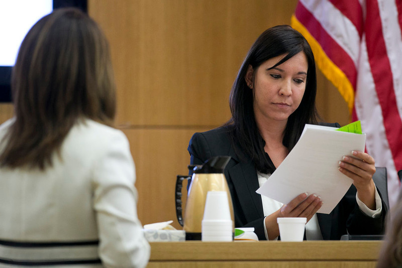 . Dr. Janeen DeMarte, an expert witness for the prosecution,  looks at material as she is cross examined by defense attorney Jennifer Wilmott during the Jodi Arias trial at Maricopa County Superior Court in Phoenix on Wednesday, April 17, 2013.   Arias is on trial for the killing of her boyfriend, Travis Alexander in 2008.  Arias claims self-defense but faces a potential death sentence if convicted of first-degree murder.  (AP Photo/The Arizona Republic, David Wallace, Pool)