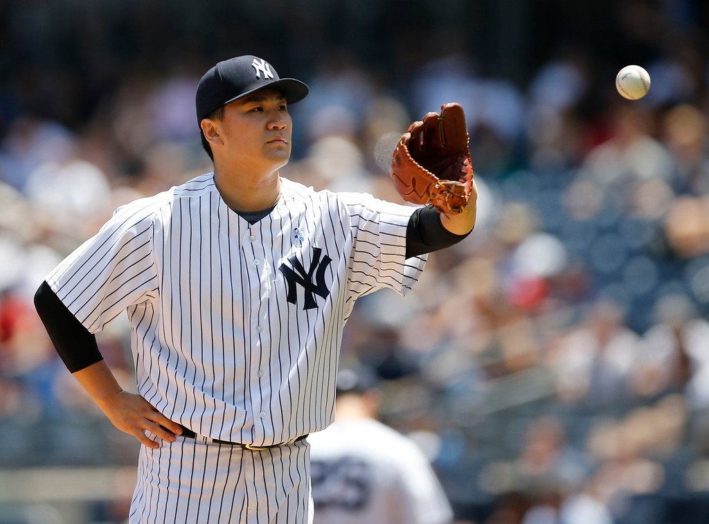 . New York Yankees starting pitcher Masahiro Tanaka waits for a ball after allowing the second of two first-inning, two-run home runs in a baseball game against the Detroit Tigers at Yankee Stadium in New York, Sunday, June 21, 2015. (AP Photo/Kathy Willens)