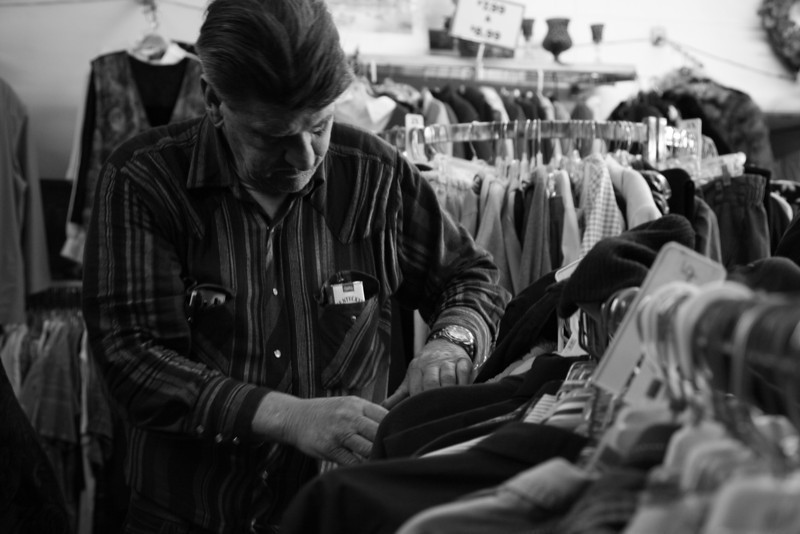 Minor James Miller Junior picks out a new jacket at a second hand shop on Broadway Avenue in Mattoon, Illinois on March 3, 2009.   (Jay Grabiec)