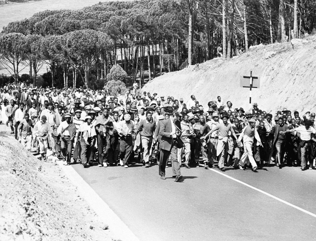 . Black South Africans jam a road in Cape Town, March 30, 1960, on their way to demonstrate in front of a police station in protest against the jailing of their leaders.  Police arrested more than 100 leaders of political parties opposed to the government\'s racial policies in a series of pre-dawn raids. (AP Photo)