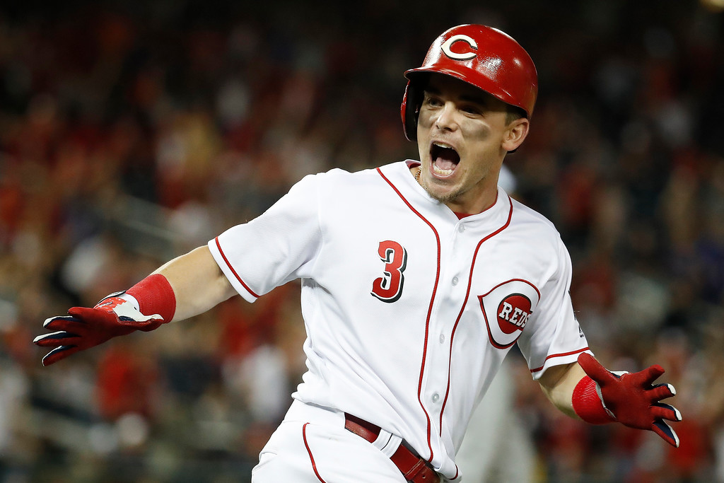 . Cincinnati Reds Scooter Gennett (3) celebrates his two-run homer in the ninth inning during the Major League Baseball All-star Game, Tuesday, July 17, 2018 in Washington. (AP Photo/Alex Brandon)