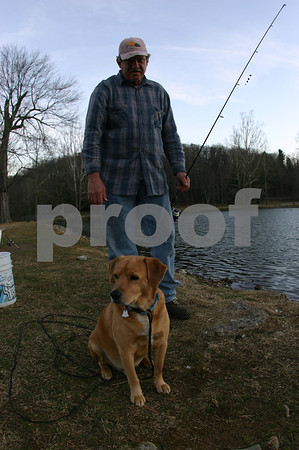 Man Fishes with Dog at Fishery Park - January 2008
