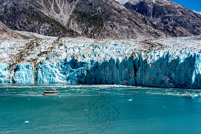 Wide view of glacier face with tourist boat