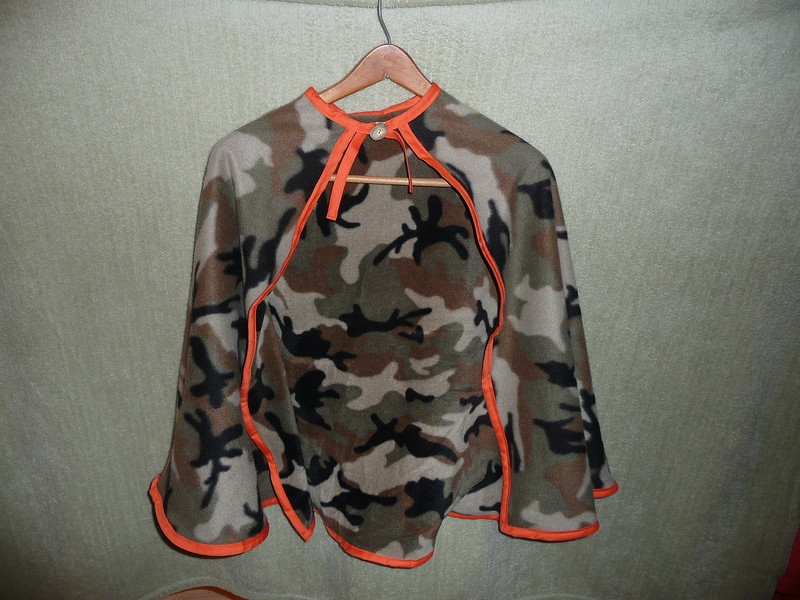 #1 - Cammo design with elk antler button - $15 or two for $25  (All capes are fleece and have velcro closure at the neck)