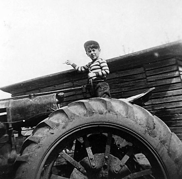 George driving tractor.JPG