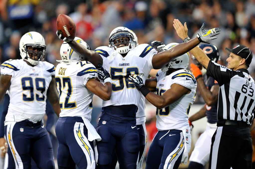 . San Diego Chargers inside linebacker Donald Butler (56) celebrates after intercepting a ball during the first half of the preseason NFL football game against the Chicago Bears, Thursday, Aug. 15, 2013, in Chicago. (AP Photo/Jim Prisching)