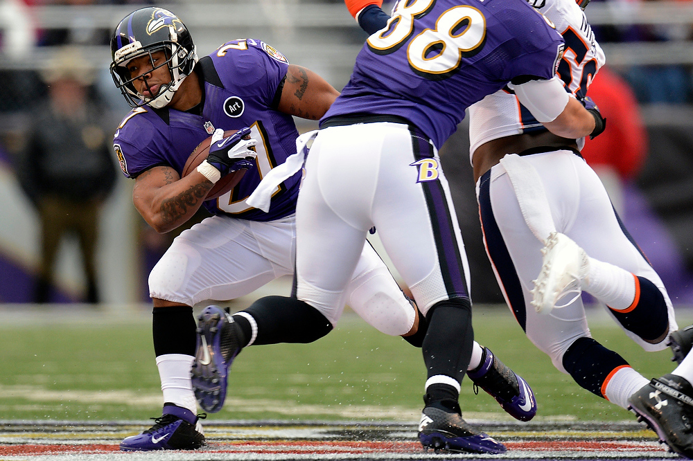 Description of . Baltimore Ravens running back Ray Rice #27 gains yards against the Broncos early in their game at the M&T Bank Stadium, in Baltimore , MD Sunday December 16, 2012.      Joe Amon, The Denver Post