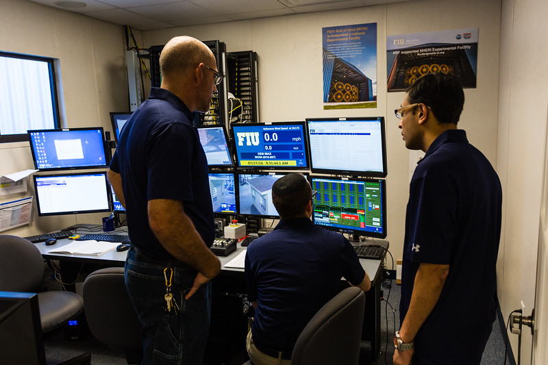 Walter Conklin (left) Lab Manager, Raphael Greenbaum (center), Research Specialist and Bodhisatta Hajra, Research Scientist talk in the FIU Wall of Wind control room at the FIU Engineering Center in Miami Dade on Wednesday, July 27, 2016. FIU hosted a demonstration to show the impact of hurricane-force winds on a scaled down model home. (Joseph Forzano / The Palm Beach Post)