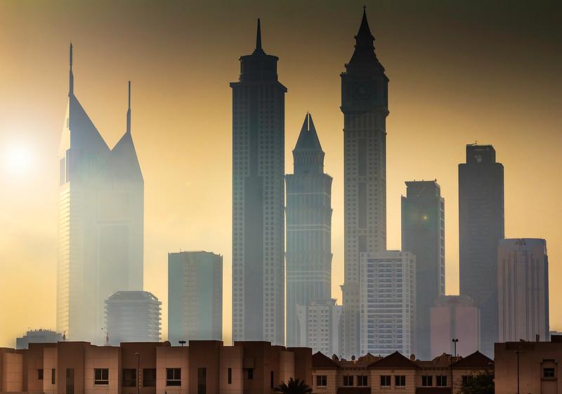 View of part of Dubai skyline from a suburban neighborhood.