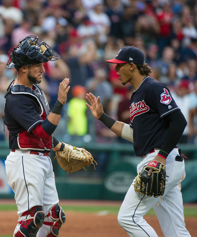 . Cleveland Indians\' Yan Gomes congratulates Erik Gonzalez after the Indians 8-4 win over the Kansas City Royals baseball game in Cleveland, Saturday, Sept. 16, 2017. (AP Photo/Phil Long)