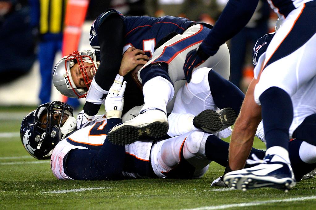 . Outside linebacker Von Miller #58 of the Denver Broncos sacks quarterback Tom Brady #12 of the New England Patriots at Gillette Stadium in Foxborough MA, November 24, 2013 Denver. (Photo By Joe Amon/The Denver Post)