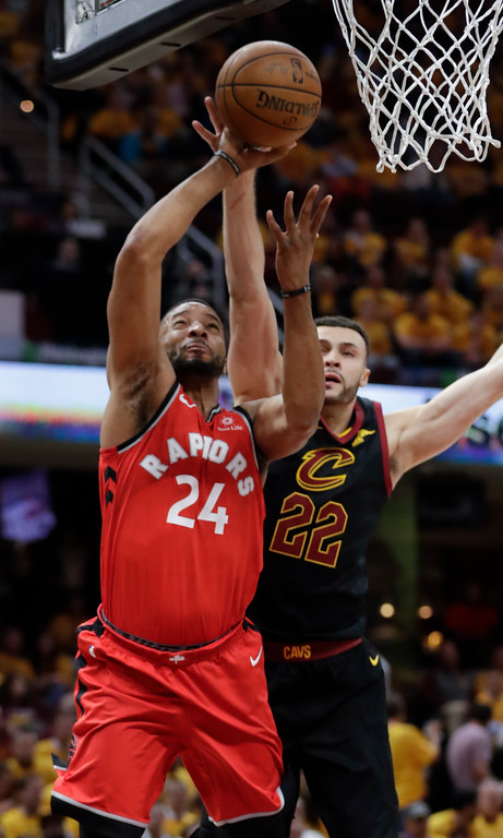 . Toronto Raptors\' Norman Powell (24) shoots against Cleveland Cavaliers\' Larry Nance Jr. (22) in the second half of Game 4 of an NBA basketball second-round playoff series, Monday, May 7, 2018, in Cleveland. (AP Photo/Tony Dejak)