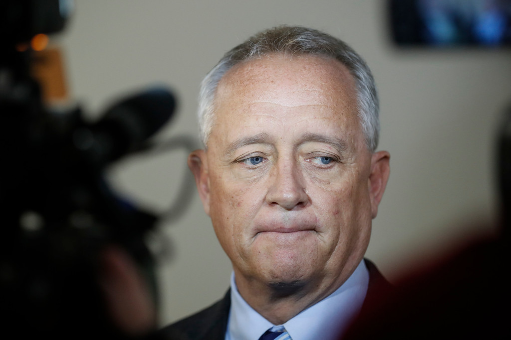 . Hamilton County Prosecutor Joseph Deters speaks to the media outside court after Common Pleas Court Judge Megan Shanahan declares a mistrial due to a hung jury in the murder trial against Ray Tensing, Saturday, Nov. 12, 2016, in Cincinnati. Tensing, the former University of Cincinnati police officer, is charged with murdering Sam DuBose while on duty during a routine traffic stop on July 19, 2015. (AP Photo/John Minchillo)