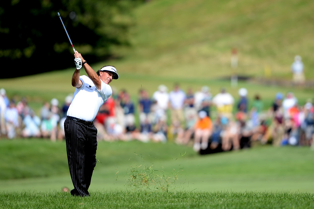 . Phil Mickelson of the United States hits his second shot on the second hole during Round Two of the 113th U.S. Open at Merion Golf Club on June 14, 2013 in Ardmore, Pennsylvania.  (Photo by Ross Kinnaird/Getty Images)