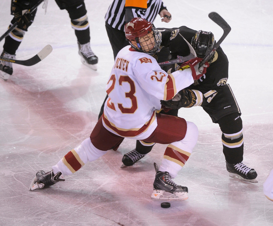 . DENVER, CO. - NOVEMBER 16: Denver freshman Matt Marcinew (23) faced off against Western Michigan center Chase Balisy (13) in the second period. The University of Denver hockey team hosted Western Michigan at Magness Arena Saturday night, November 16, 2013.  Photo By Karl Gehring/The Denver Post