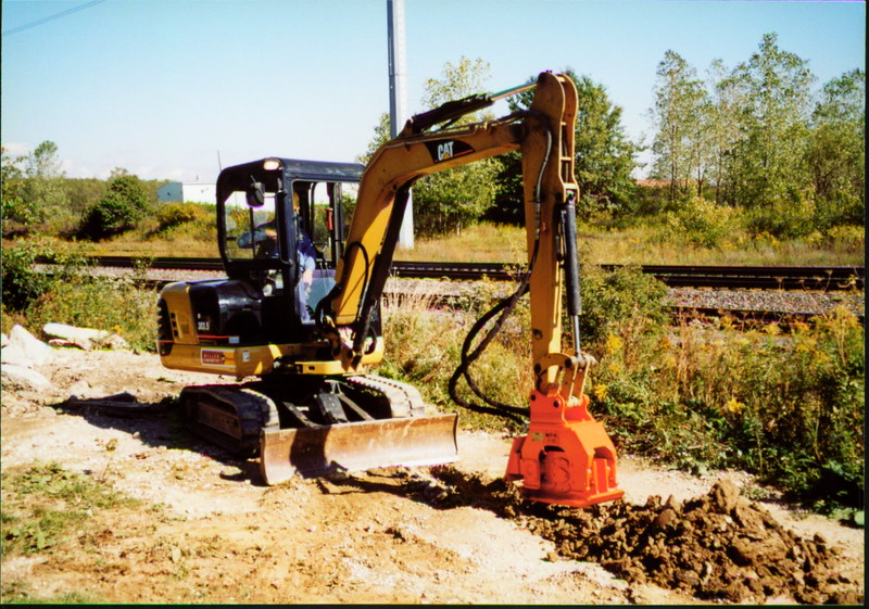 NPK C2C compactor with backfill blade on Cat mini excavator (12).JPG