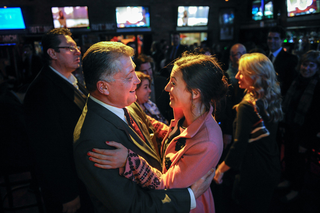 . Carmen Trutanich gets a hug from his daughter Caitlin Trutanich at the campaign party at Rocco\'s Tavern in Studio City, Tuesday, March 5, 2013. (Michael Owen Baker/Staff Photographer)