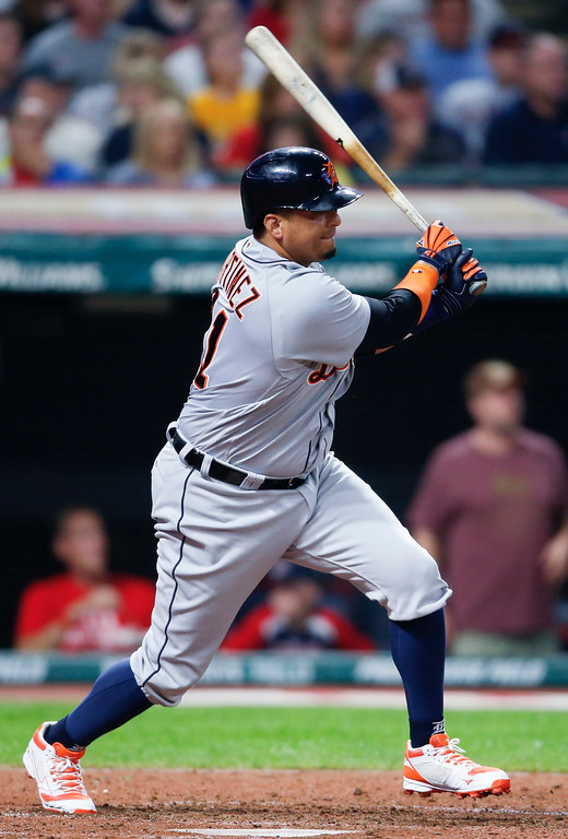 . Detroit Tigers\' Victor Martinez hits a one run double off Cleveland Indians\' Andrew Miller during the seventh inning of a baseball game, Friday, Sept. 14, 2018, in Cleveland. (AP Photo/Ron Schwane)