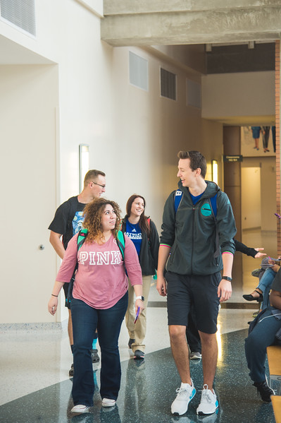 Karla Garza (left), Christ Buck, Trevor K. Baumann and Cayce Marlatt make their way through Island Hall.