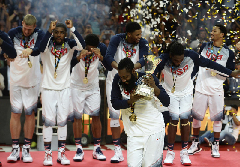 . US forward James Harden (front) and his teammates celebrate after winning the 2014 FIBA World basketball championships final match USA vs Serbia at the Palacio de los Deportes in Madrid on September 14, 2014. USA won the match 129-92.  GERARD JULIEN/AFP/Getty Images