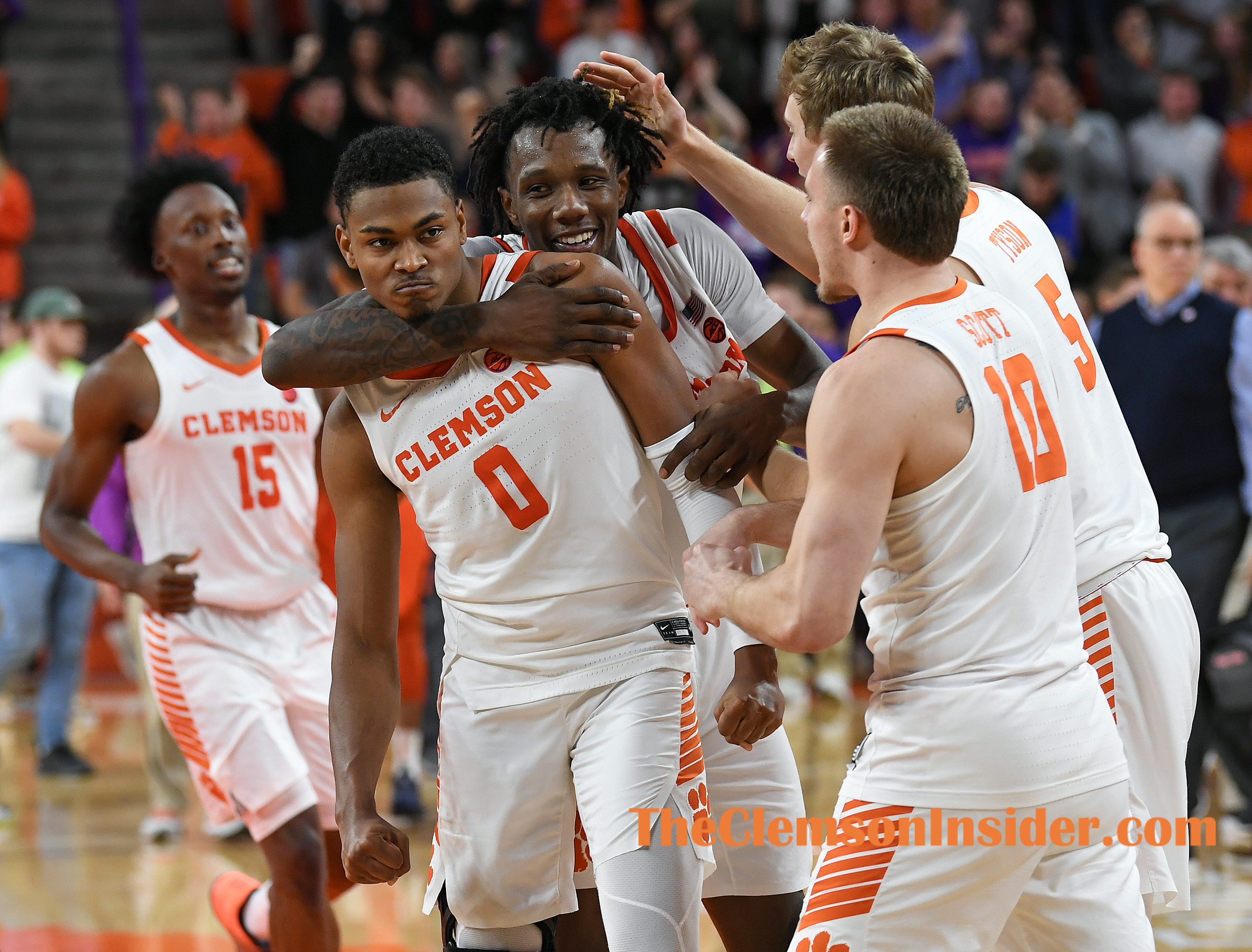 Clemson's from left, Clyde Trapp (0), Tevin Mack (13), Hunter Tyson (5), and Curran Scott (10) celebrate after the Tigers defeated Syracuse 71-70 Tuesday, January 28, 2020 at Clemson's Littlejohn Coliseum. Bart Boatwright/The Clemson Insider