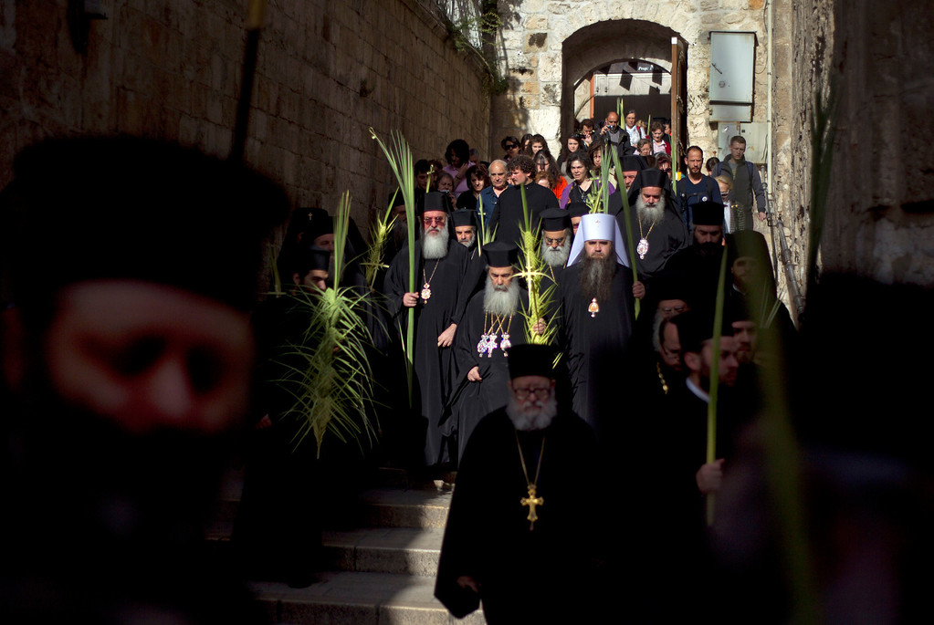 . Greek Orthodox Patriarch of Jerusalem Theophilos III leads the Palm Sunday procession at the Church of the Holy Sepulchre, traditionally believed by many to be the site of the crucifixion and burial of Jesus Christ, during Palm Sunday celebrations in Jerusalem\'s Old city, Sunday, April 28, 2013. Palm Sunday marks for Christians, Jesus Christ\'s entrance into Jerusalem, when his followers laid palm branches in his path, prior to his crucifixion.(AP Photo/Ariel Schalit)