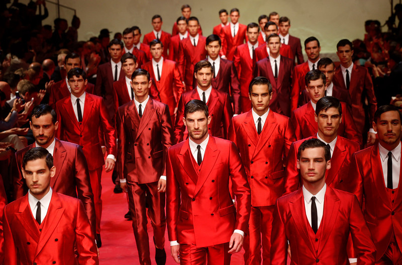 . Models wear creations for Dolce & Gabbana men\'s Spring-Summer 2015 collection, part of the Milan Fashion Week, unveiled in Milan, Italy, Saturday, June 21, 2014. (AP Photo/Luca Bruno)