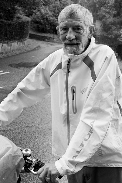 Iain #87 A true Scot, Iain was willing to take a break from pushing his bike up a steep street in the pouring rain (or as Scots would call it a heavy scotch mist) to chat. We chatted for a good 10 to 15 minutes and by the end I looked like a drowned rat. Iain looked just the same. True to form, Iain also had a link back to Canada. His sister-in-law lives here.