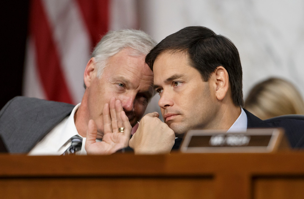 . Sen. Marco Rubio, R-Fla., right, confers with Sen. Ron Johnson, R-Wis., as Secretary of State John Kerry appears before the Senate Foreign Relations Committee to shore up President Barack Obama\'s strategy to combat Islamic State extremists in Iraq and Syria, on Capitol Hill in Washington, Wednesday, Sept. 17, 2014.   (AP Photo/J. Scott Applewhite)