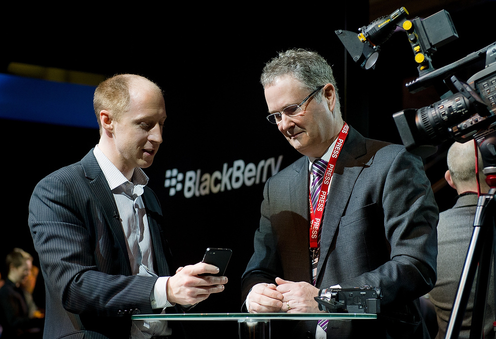 . A member of the RIM team (L) demonstrates one of the new touchscreen Z10 Blackberry devices to a television crew in central London at one of eight simultaneous worldwide events for the launch of the BB10 operating system on January 30, 2013. (LEON NEAL/AFP/Getty Images)