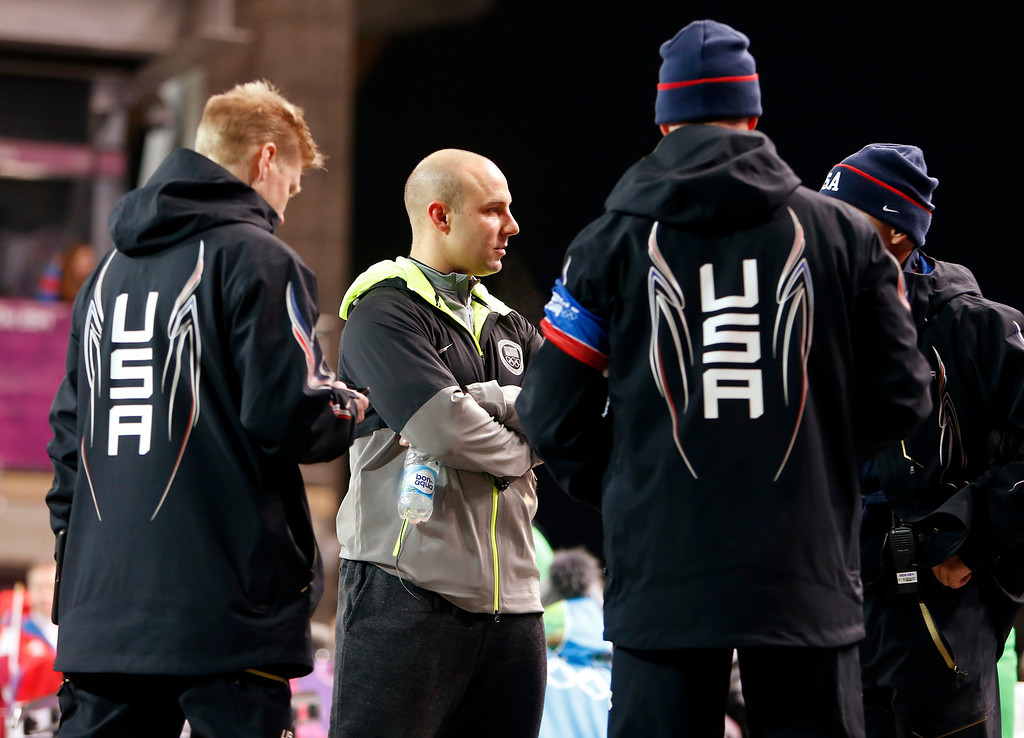 . USA bobsled driver Nick Cunningham, of Monterey, chats with other bobsledders before the Two-man Bobsleigh at the Sanki Sliding Center for the 2014 Winter Olympics in Krasnaya Polyana, Russia, on Sunday, Feb. 16, 2014.  (Nhat V. Meyer/Bay Area News Group)