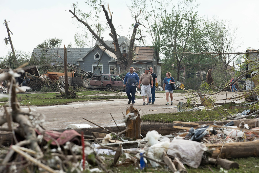 . People survey the damage caused by a tornado that hit Pilger, Neb.,  on Monday, June 16, 2014.  The National Weather Service says the storm that struck northeast Nebraska appears to have produced four tornadoes, one of which ravaged the town of Pilger.   (AP Photo/The World-Herald, Ryan Soderlin)