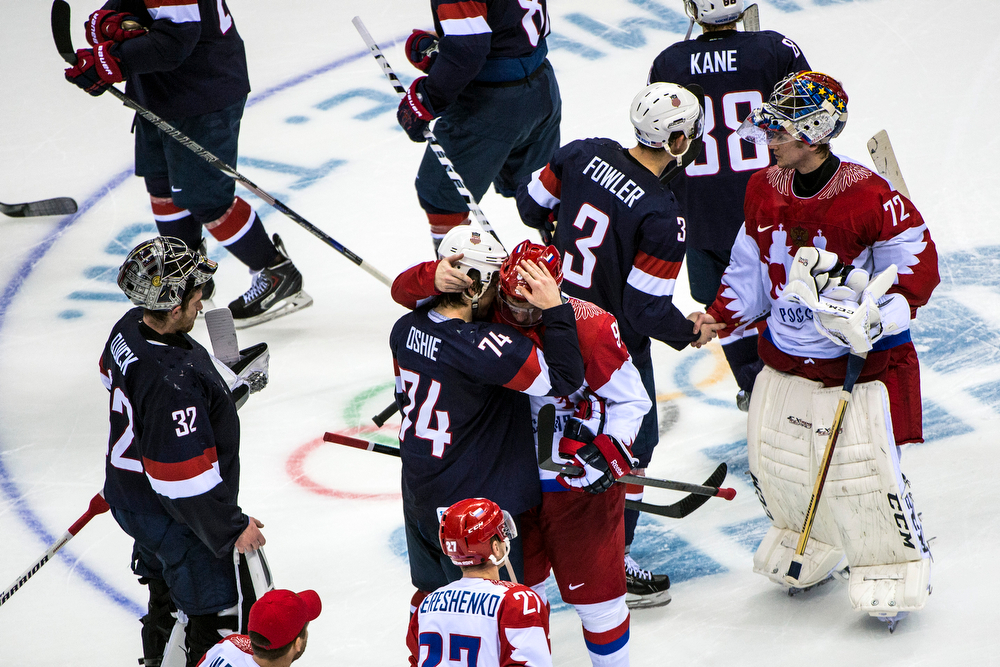 . United States\' T.J. Oshie hugs Russia\'s Vladimir Tarasenko (91) after winning the game in an overtime shootout against Russia at Bolshoy Ice Dome during the 2014 Sochi Olympics Saturday February 15, 2014.  The United States men\'s hockey team defeated Russia with a 3-2 overtime victory. (Photo by Chris Detrick/The Salt Lake Tribune)