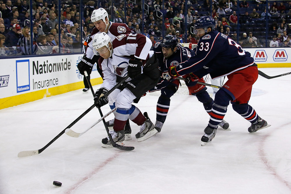 . Chuck Kobasew #12 of the Colorado Avalanche battles for control of the puck with Adrian Aucoin #33 and Fedor Tyutin #51, both of the Columbus Blue Jackets, and Cody McLeod #55 of the Colorado Avalanche during the first period on March 3, 2013 at Nationwide Arena in Columbus, Ohio. (Photo by Kirk Irwin/Getty Images)