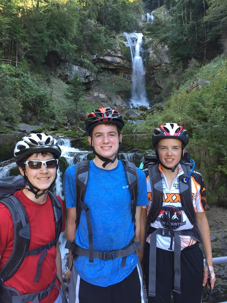 Eric, Henry, and Jack in  front of Geisbach Falls above Lake Brienz