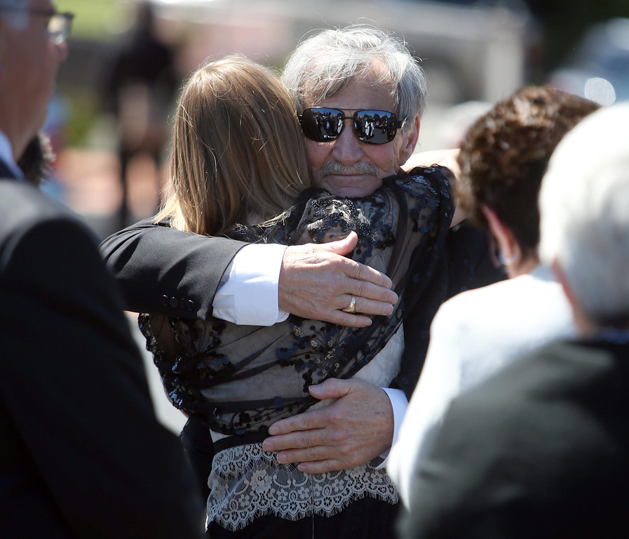 . Roger Boyer, of Oakland, center, is consoled during funeral services for his son and Santa Clara paramedic Quinn Boyer, 34, of Dublin, at St. Theresa Catholic Church in Oakland, Calif., on Tuesday, April 16, 2013.  (Jane Tyska/Staff)