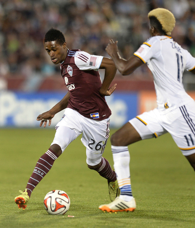 . COMMERCE CITY, CO - MAY 3:  Colorado forward Deshorn Brown (26) tried to get past Galaxy forward Gyasi Zardes (11) in the second half. The Colorado Rapids defeated the Los Angeles Galaxy 1-0 Saturday night, May 3, 2014 at Dick\'s Sporting Good Park. (Photo by Karl Gehring/The Denver Post)