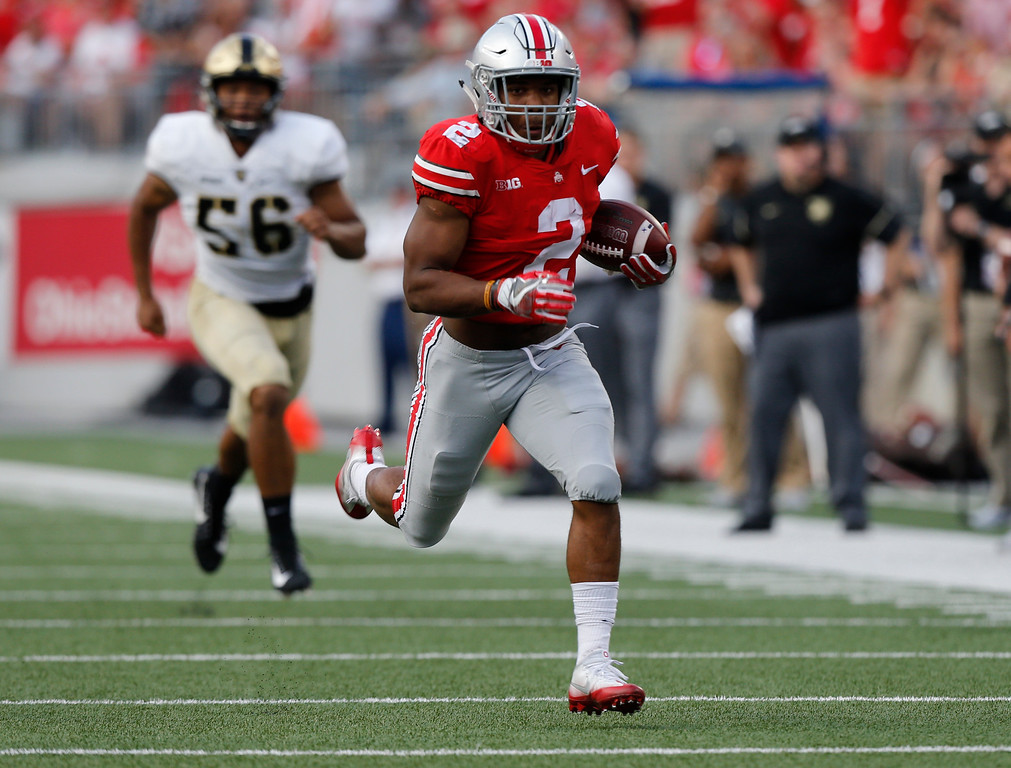 . Ohio State running back J.K. Dobbins outruns the Army defense to score a touchdown during the second half of an NCAA college football game Saturday, Sept. 16, 2017, in Columbus, Ohio. (AP Photo/Jay LaPrete)