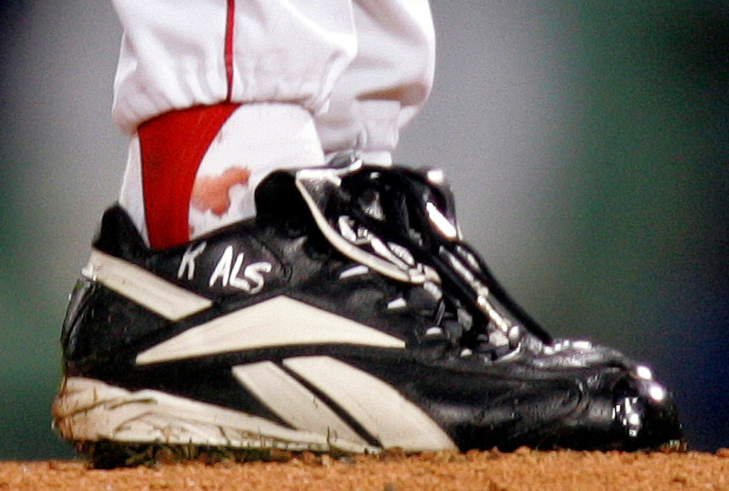 . Blood is seen around the ankle of Boston Red Sox pitcher Curt Schilling during the first inning of Game 2 of the World Series in Boston, Sunday, Oct. 24, 2004. Schilling was pitching with a dislocated ankle tendon held together by suture.   (AP Photo/Winslow Townson)