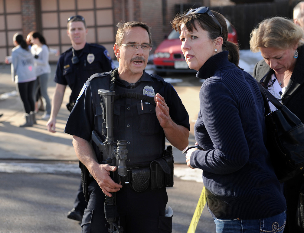 . CENTENNIAL, CO. - DECEMBER 13: Parents waited to be reunited with their children outside Arapahoe High School Friday afternoon, December 13, 2013. A shooting inside the school sent hundreds of students rushing for safety. Photo By Karl Gehring/The Denver Post