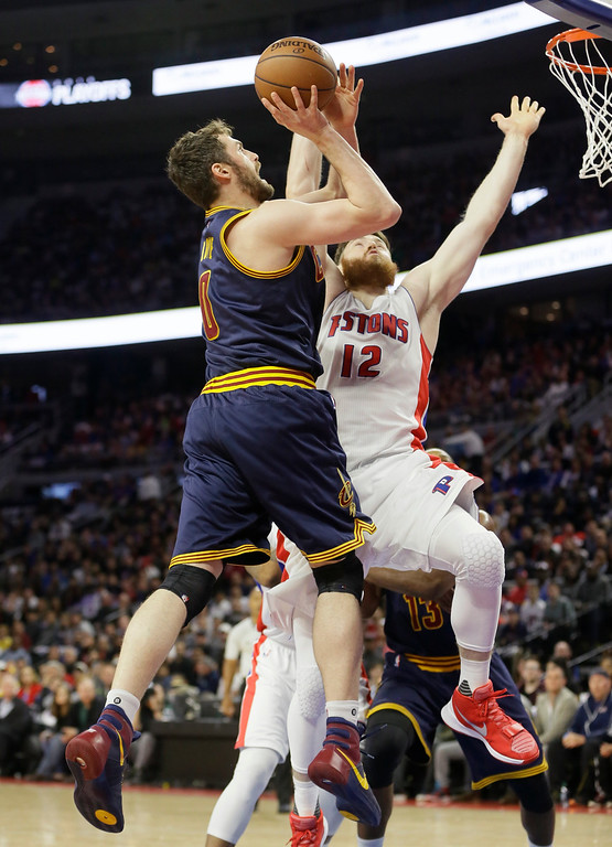 . Cleveland Cavaliers forward Kevin Love (0) shoots over Detroit Pistons center Aron Baynes (12) during the first half in Game 4 of a first-round NBA basketball playoff series, Sunday, April 24, 2016 in Auburn Hills, Mich. (AP Photo/Carlos Osorio)