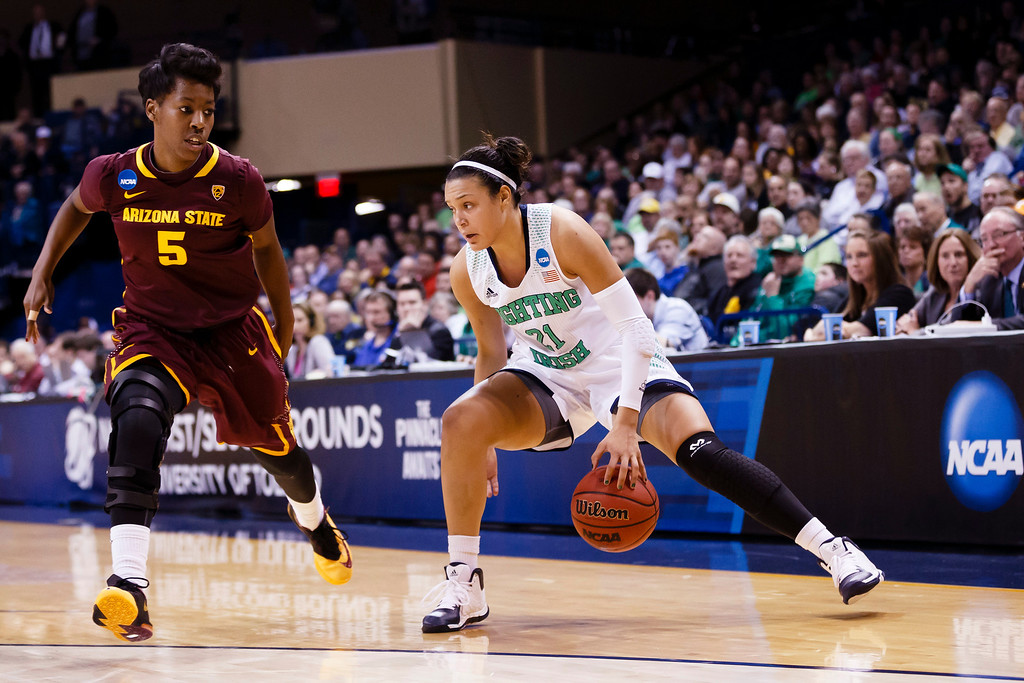 . Notre Dame guard Kayla McBride (21) dribbles around Arizona State guard Deja Mann (5) during the second half in a second-round game in the NCAA women\'s college basketball tournament in Toledo, Ohio, Monday, March 24, 2014. Notre Dame defeated Arizona State 84-67. (AP Photo/Rick Osentoski)